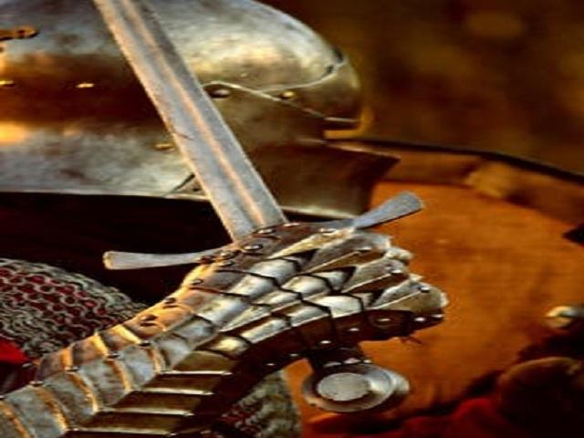 Man i rustning med svärd